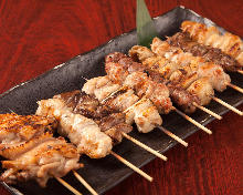 Assorted grilled chicken skewers