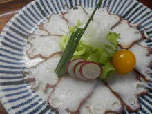 Thinly sliced octopus sashimi