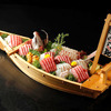 Whole fish sashimi arranged in the original shape served in boat-like-plate