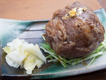 Beef wrapped rice ball