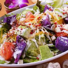 Caesar salad with purple sweet potato