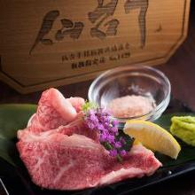 Wagyu beef grilled with rock salt, with soy sauce and wasabi