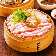 Vegetables and pork steamed in a bamboo steamer