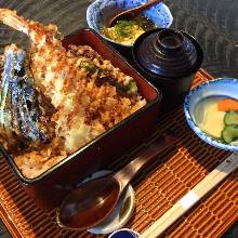 Tempura served over rice in a lacquered box