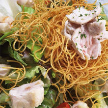 Salad topped with crispy fried noodles