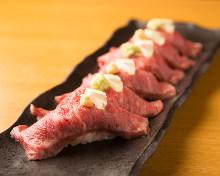 Beef nigiri sushi topped with sea urchin