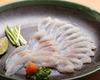 Thinly-sliced blowfish sashimi