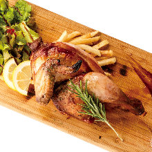 Grilled half-chicken of the day with herbs: Served with smoked salt and smoked black pepper