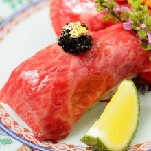 Meat sushi with caviar