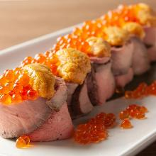 Meat-wrapped gunkan sushi rolls topped with sea urchin
