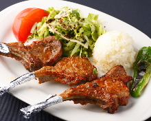 Charcoal grilled lamb meat on the bone