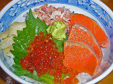 Salmon roe, salmon, and negitoro (tuna paste with green onion) rice bowl