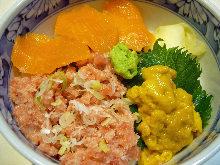 Seafood rice bowl with tuna, salmon and sea urchin