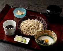 Chilled buckwheat soba noodles served on a bamboo strainer with grated yam dipping sauce