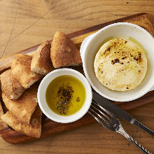 Oven-baked camembert cheese