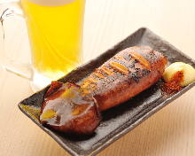 Squid poppo-yaki (Grilled squid mantle stuffed with squid tentacles and entrails)