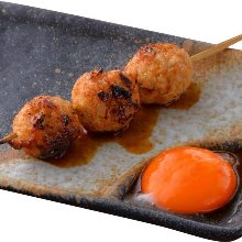 Grilled meatball skewer with egg yolk