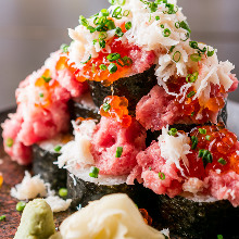 Overflowing seafood sushi