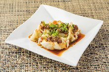 Boiled gyoza with chili oil sauce