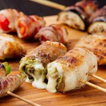 Assorted grilled vegetable roll skewers