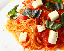 Pasta with tomato sauce, mozzarella, and basil