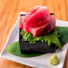 Chopped tuna served in a masu (Japanese wooden square measuring cup)
