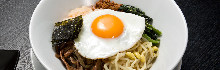 Bibimbap topped with sunny-side-up egg