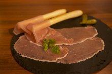 Prosciutto wrapped grissini (breadsticks)