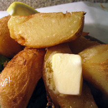 Potatoes, topped with butter or salt-fermented squid