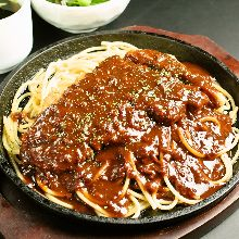 Pasta with curry sauce, topped with pork cutlet