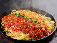 Pasta with meat sauce, topped with pork cutlet