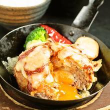 Soft-boiled egg stuffed meatball meal