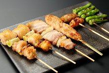 Assorted grilled chicken skewers