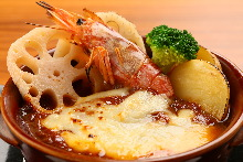 Demi-glace sauce gratin of seafood and root vegetable