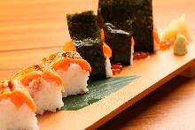 Seared salmon rod-shaped sushi