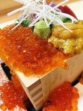 "Overflowing sushi in ""masu"" measuring box"