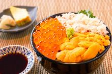 Seafood rice bowl with sea urchin, salmon roe, and crab