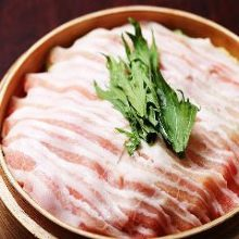 Pork steamed in a bamboo steamer
