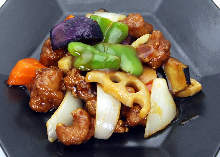 Sweet and sour pork and soybean meat with black vinegar