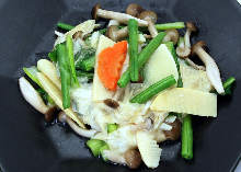 Stir-fried green leaves and yuba (tofu skins)