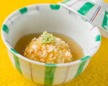 Deep-fried rice cake in broth