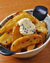 Fried unpeeled potatoes with salt kelp butter