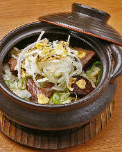 Garlic fried rice with seared beef in donabe (an earthen pot)