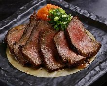 Thinly-sliced rare Wagyu beef steak with grated daikon and ponzu