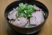 Grilled pork over rice in a lacquered box