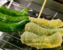 Fried shishito pepper skewer