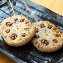 Grilled meat-stuffed lotus root skewer