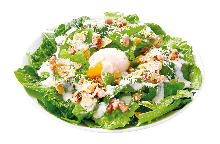 Caesar salad with soft-boiled egg and bacon