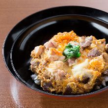 Locally raised chicken and egg rice bowl with offal