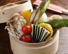 Vegetables steamed in a bamboo steamer
